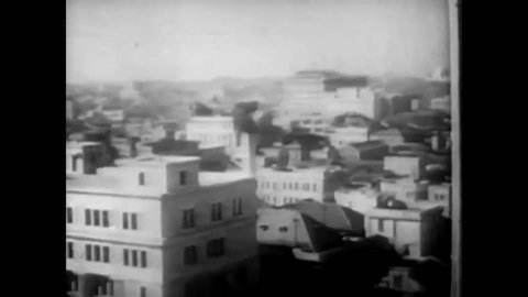 CIRCA 1942 - Tokyo seems undeterred by the chance of attack by American planes, as they have been forewarned about the possibility (narrated in 1953).