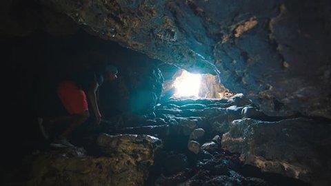 Boy walking in Shete Boka cave, Curacao