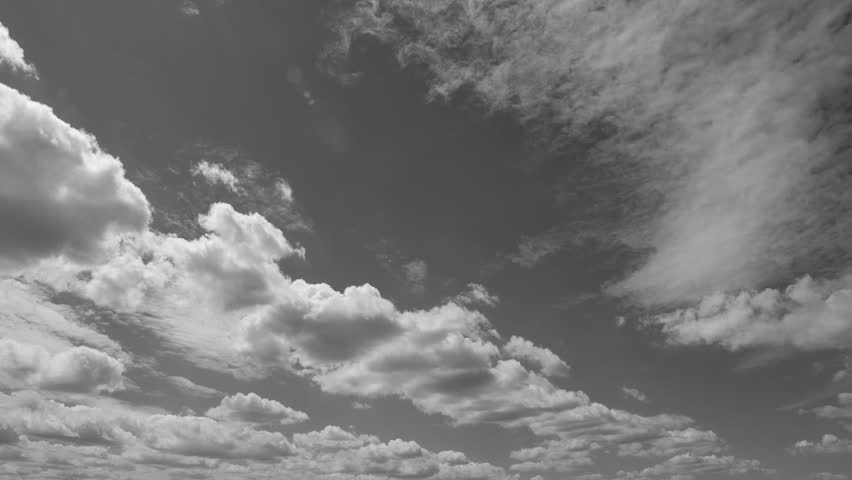 The clouds are moving in the blue sky. Black and white.  | Shutterstock HD Video #1013640185