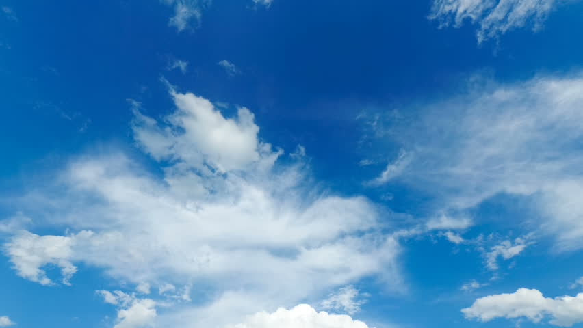 Clouds are Moving in the Blue Sky. Time Lapse. Beautiful White fluffy clouds over blue sky soar in Timelapse. #1013703005