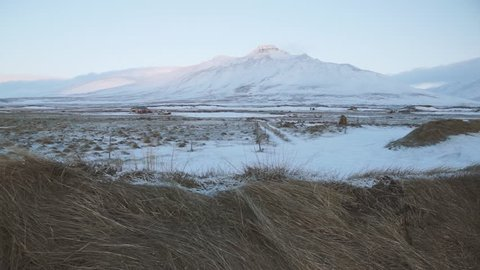 Mountain in Skagaströnd, Iceland, a sleepy fishing village in the north of Iceland. Filmed in the winter months in the cold ice and snow.