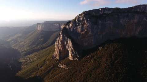 Aerial drone shot flying towards a mountain in vercors massif France. Sunset  time.