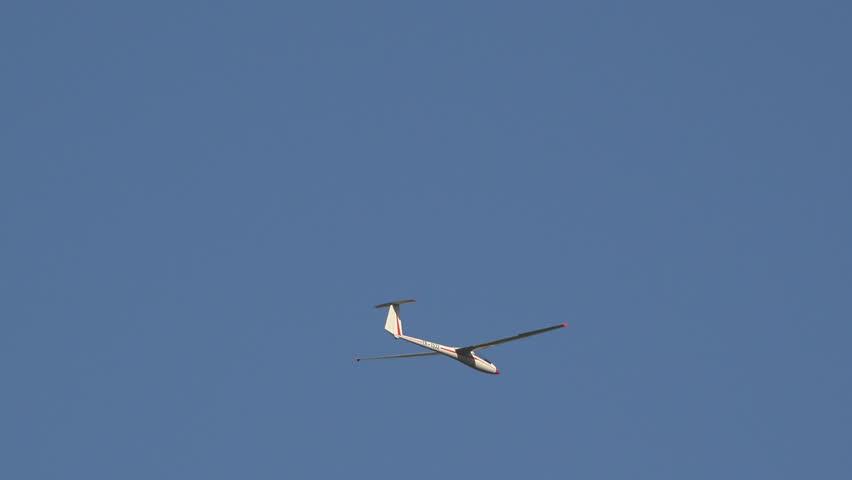 Air glider fly on blue sky