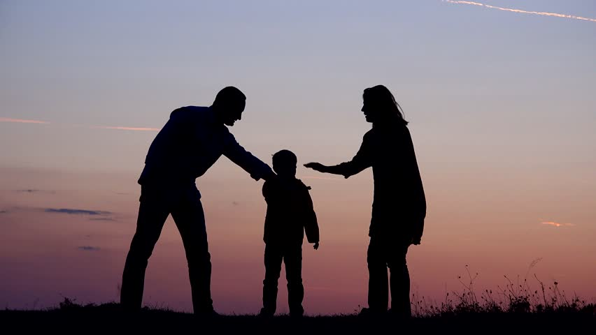Family silhouettes put hands together, perfect team and support, sunset deal | Shutterstock HD Video #1013780555