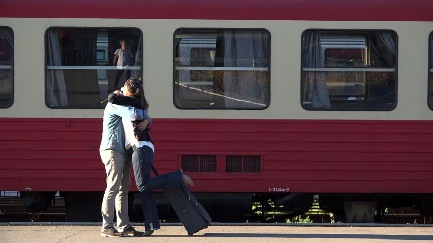 Happy meeting in train station, man offering white flower   Shutterstock HD Video #1013787965