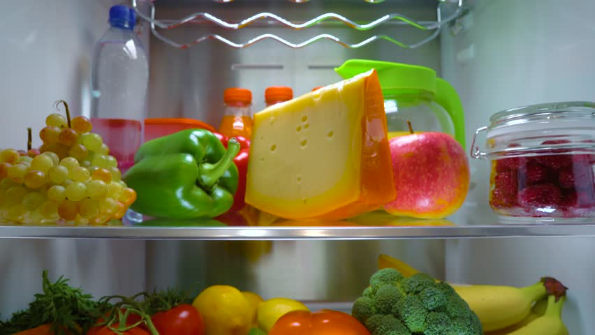 Open refrigerator filled with food. Healthy food.   Shutterstock HD Video #1013810735