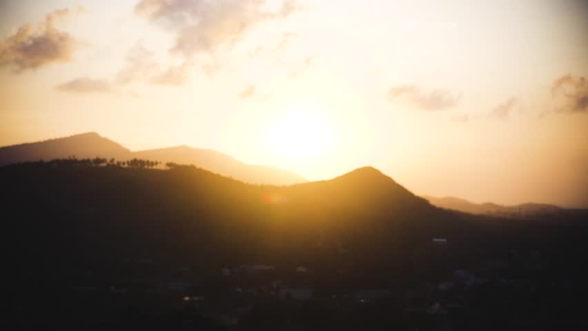 Two cheerful young people meet at sunset high on the mountain, give each other a heel in a jump, and hit with assholes. Slow motion, HD, 1920x1080   Shutterstock HD Video #1013846375