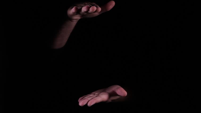 Hand Gestures coming out of the dark into the light.