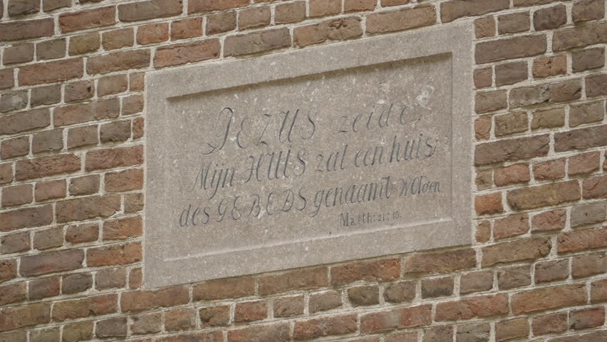 """Plaque on the little Van Gogh church in Nuenen. Painting: """"Congregation Leaving the Reformed Church in Nuenen"""" which was stolen in 2002 and recovered in 2016."""