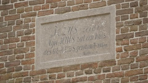 "Plaque on the little Van Gogh church in Nuenen. Painting: ""Congregation Leaving the Reformed Church in Nuenen"" which was stolen in 2002 and recovered in 2016."
