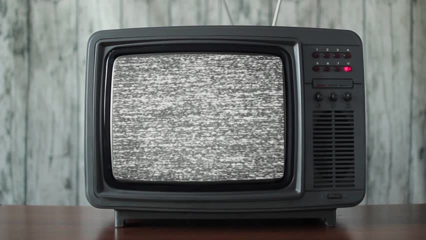 No signal just noise on a small TV in a room | Shutterstock HD Video #1013914835