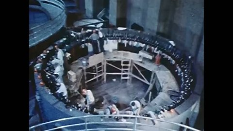 Circa 1950s - powerhouse crews prepare a pit as the n8 generator is  assembled and brought online, at hoover dam, in 1959