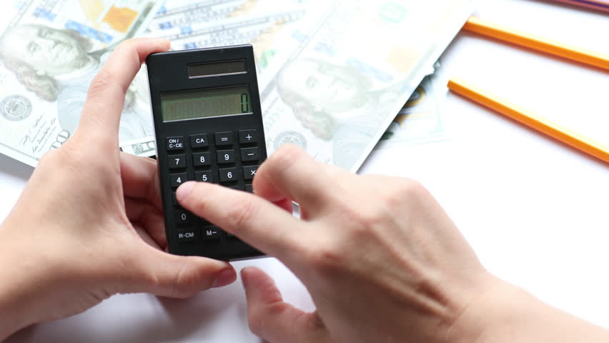 Counting money with calculator, money and notebook on the desk   Shutterstock HD Video #1013924675