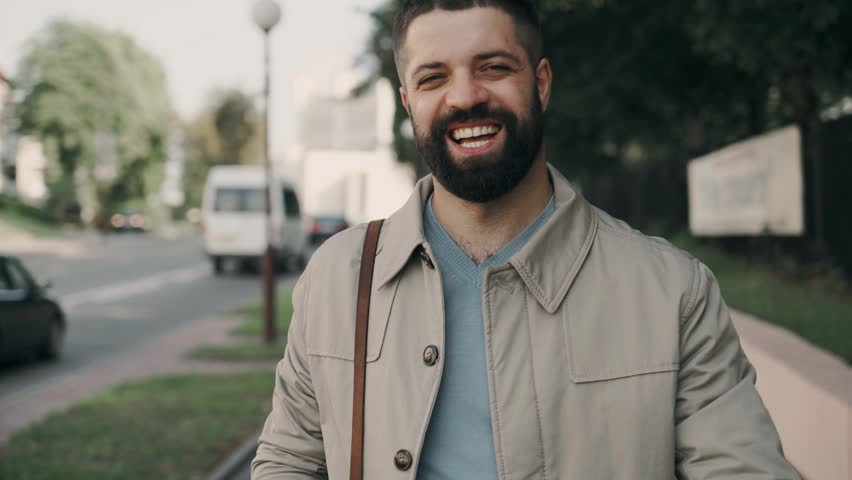 A bearded businessman walks down the street and was happy | Shutterstock HD Video #1013926955