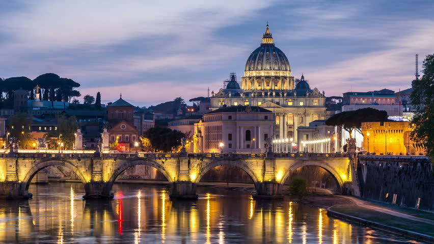 The Sant'Angelo bridge and the St. Peter's Basilica dome in the background. Day to night time lapse video.