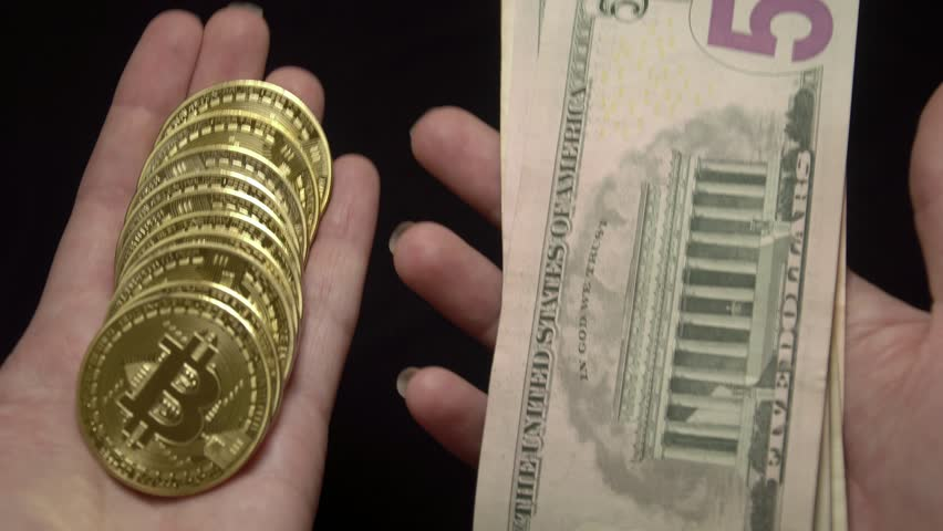 Weighting Bitcoins and American Dollars Banknotes. National Currency of the USA. Digital Currency and Traditional Cash Money   Shutterstock HD Video #1013939405