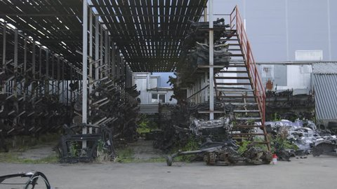 Racks with many different spare parts: beams of automobile suspension, steering racks, automobile suspension, shock absorbers, stabilizers assembled.