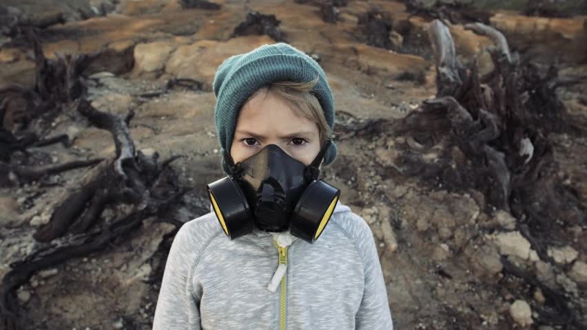 Environmental pollution, ecological disaster, nuclear war, post apocalypse concept. Care for future generations. Child in protective mask, face-guard to prevent breathing toxic air.