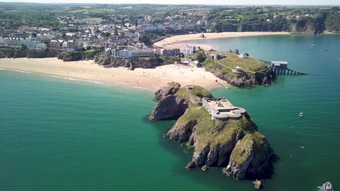 Aerial drone view of St Catherine's Fort and island next to the Welsh holiday resort of Tenby and its sandy beaches