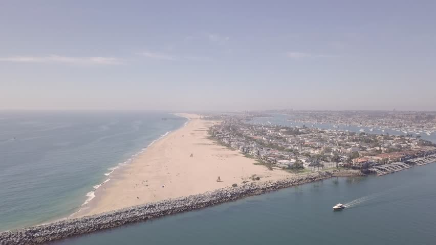 Newport Beach Wedge, In Southern California 4K (REC709)  4K REC709 Drone Footage The Newport Beach Peninsula and Famous Wedge Surf Area on a beautiful Clear Summer Day.