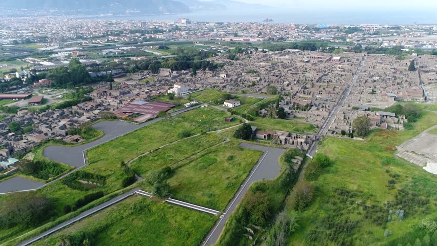 Aerial bird view footage of Pompeii an ancient Roman city near Naples in Campania region of Italy in territory of comune of Pompei Pompeii along with Herculaneum and many villas in surrounding area 4k