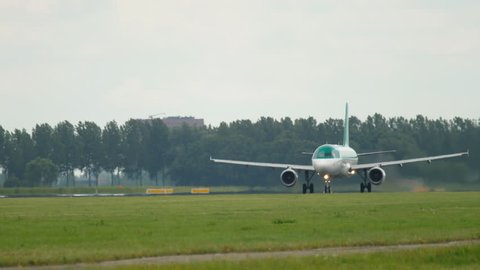 AMSTERDAM, THE NETHERLANDS - JULY 25, 2017: Aer Lingus 320 accelerate and take-off at Polderbaan 36L, rainy weather, Shiphol Airport, Amsterdam, Holland