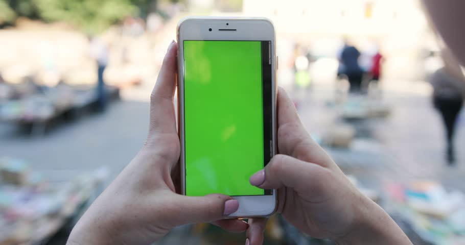 PARIS, FRANCE- APRIL 05, 2017: Close up woman hand holding use mobile smart phone with chroma green screen and touch to zoom display new technology outdoor message device adult digital | Shutterstock HD Video #1014104345