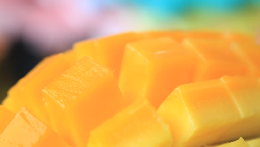 Close up the fresh thai yellow mango with rotating 360 degrees.