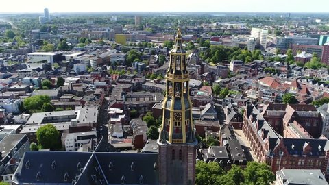 Aerial footage turning camera around the Aa-kerk tower this church is historic parish church in centre of Groningen and dominant feature in skyline of the city together with the nearby Martinitoren
