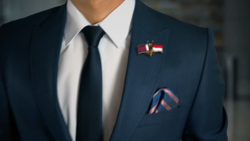 Businessman Walking Towards Camera With Friend Country Flags Pin Qatar - Monaco