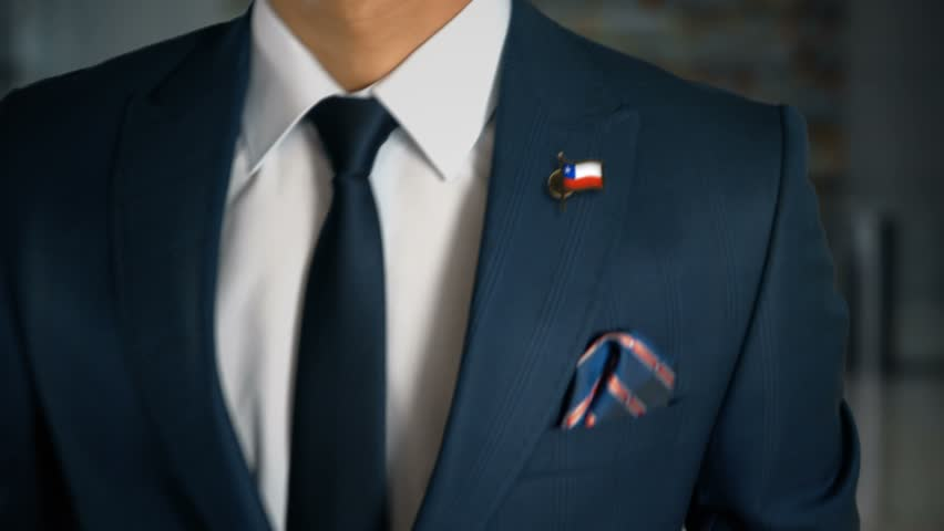 Businessman Walking Towards Camera With Country Flag Pin - Chile