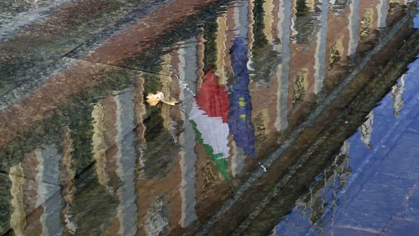Italian flag and European flag reflected in the water