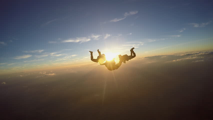 Skydivers having fun at the amazing sunset 4K video | Shutterstock HD Video #1014253505