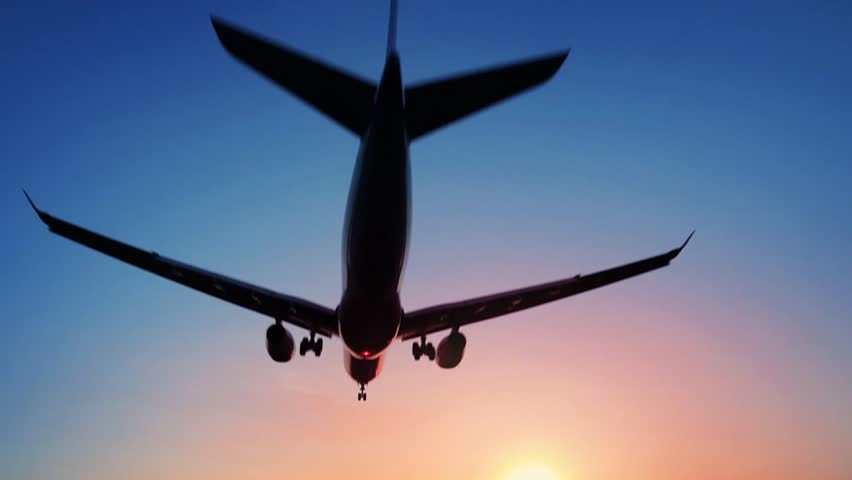 Plane landing and flying over head or taking off in sunset | Shutterstock HD Video #1014300815
