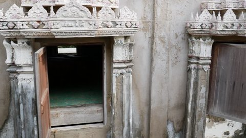 Old abandoned buddhist temple with open windows, ancient temple open to the winds, nobody inside, old temple in Thailand