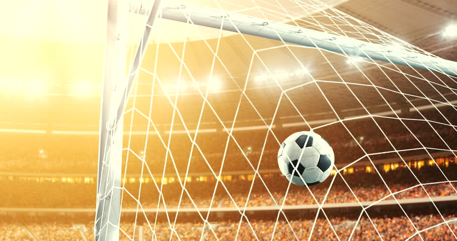 Footage of the ball that flies into a goal on a professional soccer stadium while the sun shines. Stadium and crowd are made in 3D and animated. #1014313055