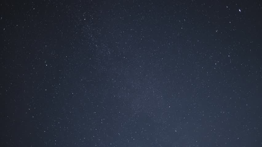 Timelapse of beautiful night sky with stars moving slowly, background in 4K UHD | Shutterstock HD Video #1014317285