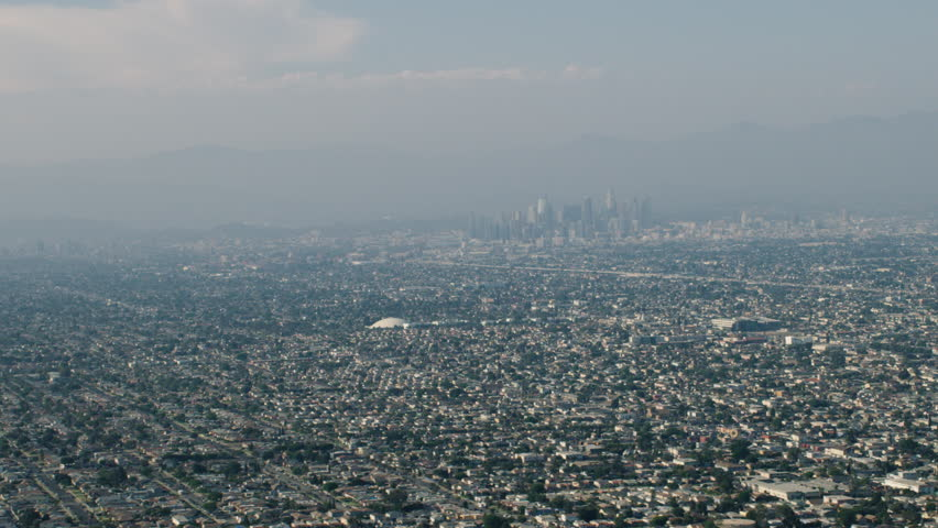 Aerial view of downtown Los Angeles in the distance during the day. Shot with a RED camera. 4k footage.