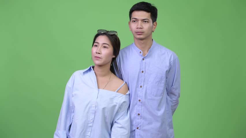 Young Asian business couple thinking together | Shutterstock HD Video #1014357725