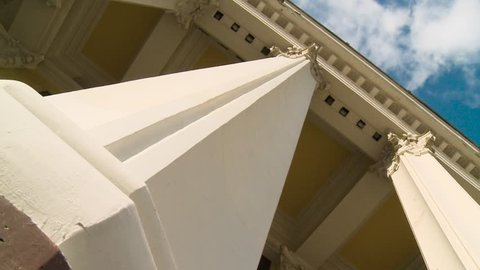 Close-up of a line of Greek-style columns. Scene. Old building with columns