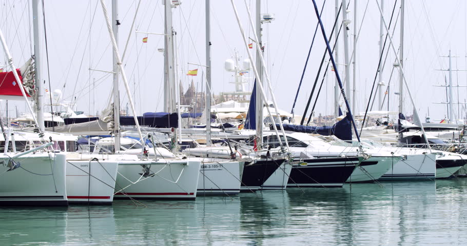 Spanish Boats in Marina Harbour. Moored Yachts at Seaside Holiday Port in Summer. A Mediterranean Tourist Sightseeing Dock for rich and wealthy millionaires.