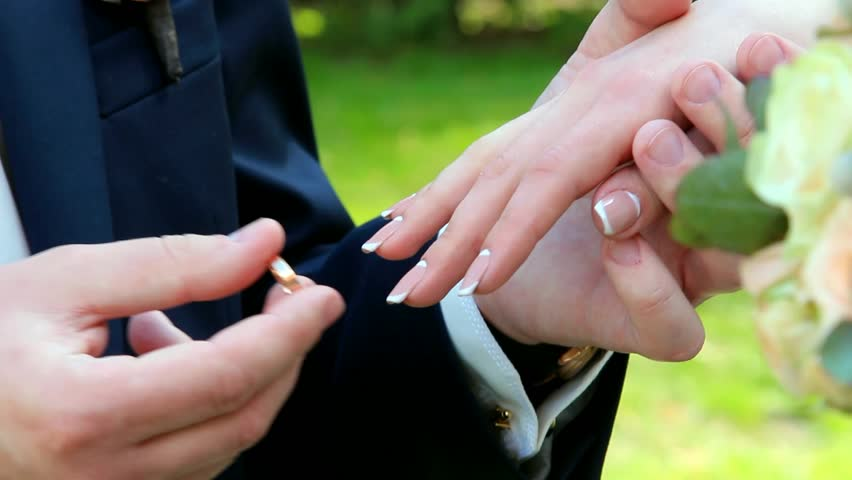 Gold Wedding Rings And Hands Of Just Married Couple Of Bride And Groom.  People Get Married. Outdoors Wedding Ceremony. Man And Woman In Love  Exchanging ...