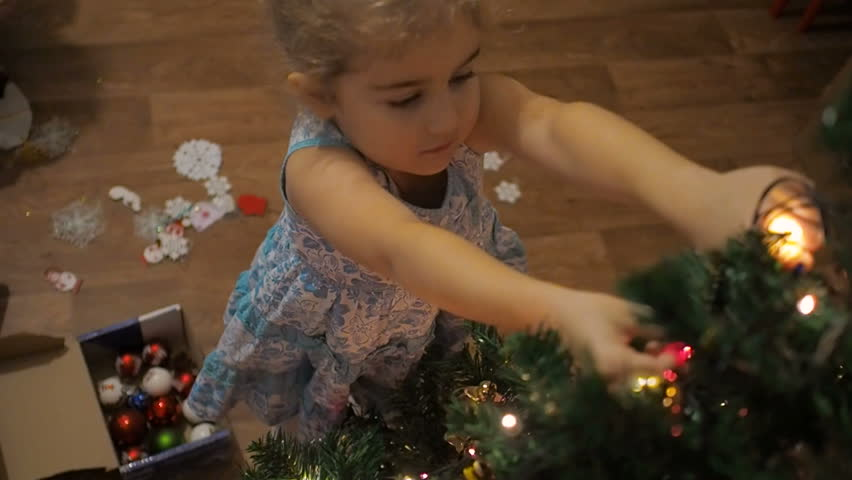 Happy  kid decorate Christmas tree. Little girl decorating christmas tree with toys and balls. | Shutterstock HD Video #1014608795