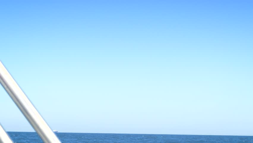 Tranquil scene of calm sea during navigation on board a sailboat in the Atlantic sea | Shutterstock HD Video #1014671165