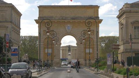 Montpellier, France - April, 2017: Tilt up view of Porte du Peyrou and Rue Foch, in Montpellier.
