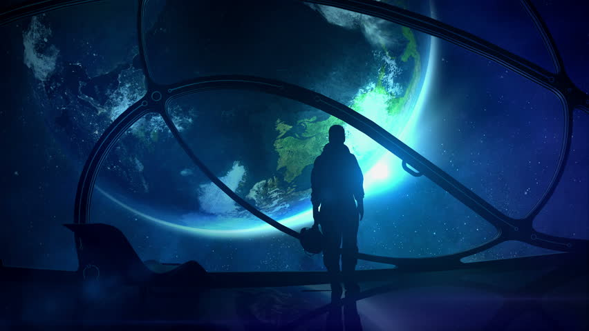 The astronaut looks at the globe | Shutterstock HD Video #1014731765