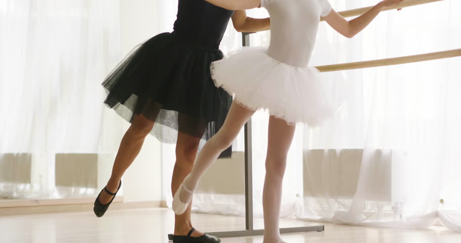 A teacher of classical dance teaches some steps to his young student who wants to learn how to dance. Concept of: ambition, education, teaching and love for the dance | Shutterstock HD Video #1014795515