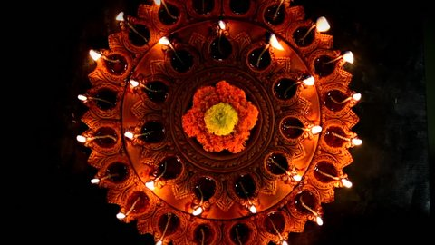 Diwali diya or oil lamp with flowers, gifts etc