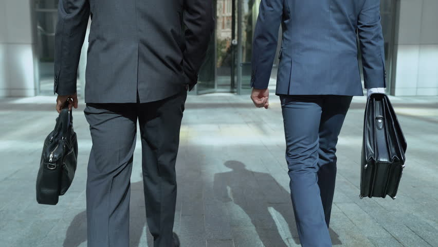 Business people going to office center, communicating, beginning of work day | Shutterstock HD Video #1014832555