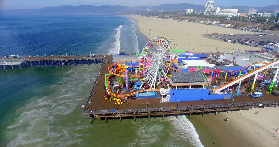 Aerial  view of Santa Monica Beach and famous iconic Pier landmark, Los Angeles, California, 4K | Shutterstock HD Video #1014863695